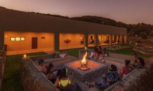 People socialising around a bon fire at Springbok Inn